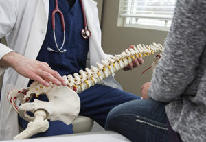 Dees Integrative Health Dr Holding Spine