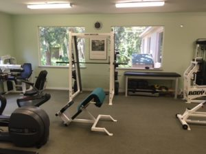 Various machines and weight lifting stations at Dr. Dee's office